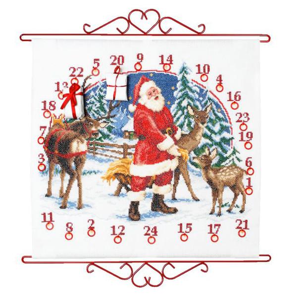 Kalenteri Joulupukki ja metsäkauriit